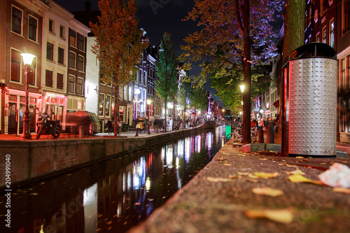 Red-light district in Amsterdam with narrow canals through the city with Night view Canvas Print