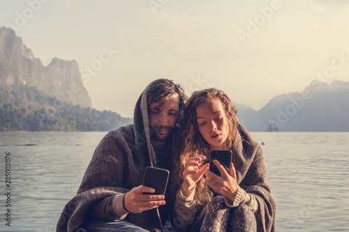 Fotobehang Stof Couple staying connected through social media