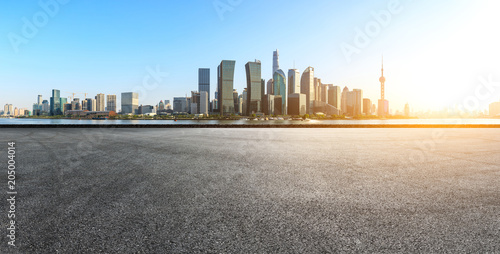 empty asphalt square road and city skyline in shanghai at sunset - 205004014