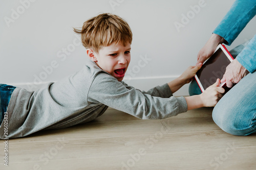 Papiers peints Fete, Spectacle computer addiction- father taking touch pad from angry child