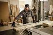 Skilled Carpenter craftsman at work in his workshop