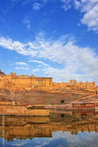Fortification Amber Fort reflected in Maota Lake near Jaipur, Rajasthan, India.