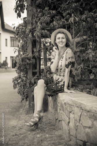 Lady in vintage dress, 1950s style on a vacation in Europe, retro style in moder Wallpaper Mural