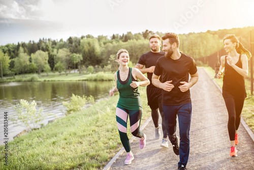 Friends jogging outdoors