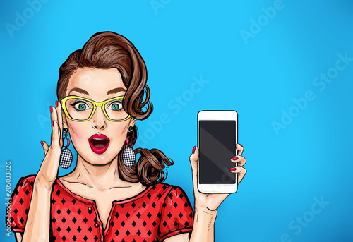 Door stickers Pop Art Attractive sexy girl in specs with phone in the hand in comic style. Pop art woman holding smartphone. Digital advertisement female model showing the message or new app on cellphone.