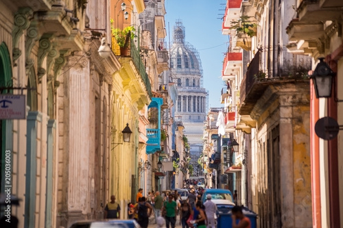 Havana, Cuba, El Capitolio seen from a narrow street
