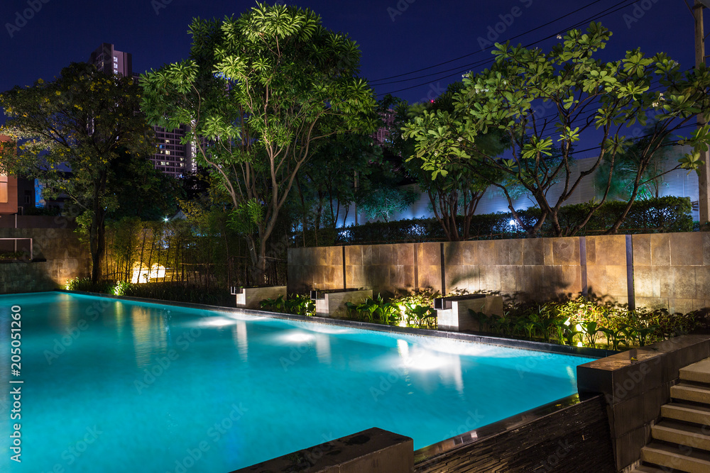 Fototapety, obrazy: Lighting business for luxury backyard swimming pool.  Relaxed lifestyle with contemporary design by professionals.