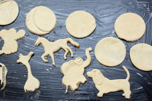 Valokuva  cookies figured on a baking sheet