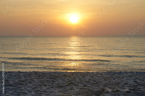 Foto op Aluminium Strand Sun on sky with sea and sand on beach with warm orange light