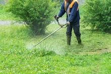 The Gardener Cutting Grass By ...