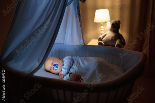 Vászonkép Baby boy in bed sleeping at night