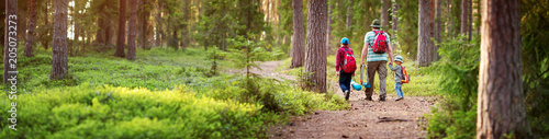 Fotografiet  Father and boys going camping with tent in nature