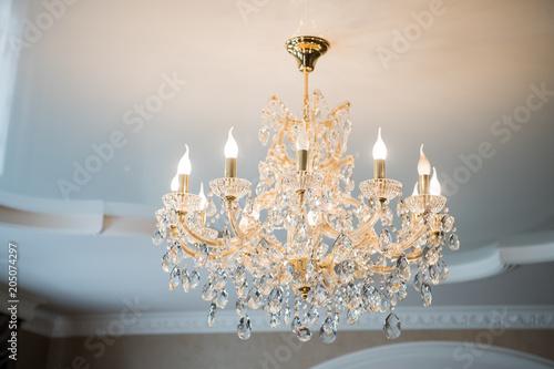 Fotomural beautiful vintage crystal chandelier in a room