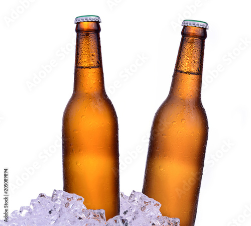 Foto op Canvas Bier / Cider Bottle of beer with drops and ice isolated on white background