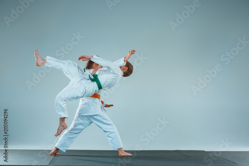 The boy fighting at Aikido training in martial arts school Wallpaper Mural