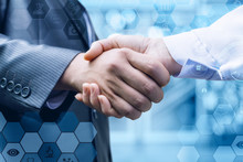 Handshake Of A Businessman And...