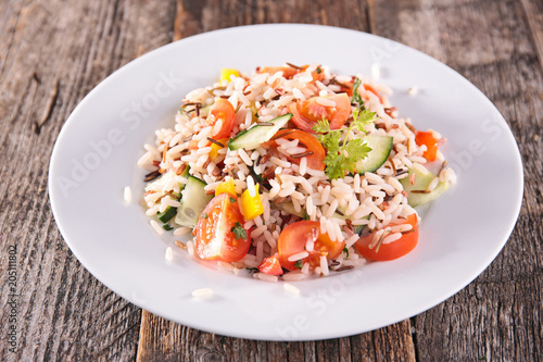 Fotobehang Edelsteen rice salad with tomato and cucumber