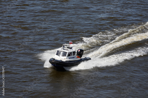 Poster Water Motor sports River police on the Vistula.