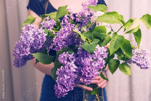 Foto op Canvas Lilac Woman holding lilac bouquet