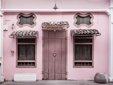 Ancient, Pink Building With A Wooden Door