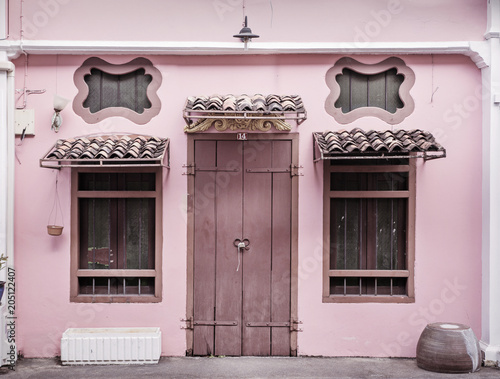 Foto op Plexiglas Artist KB Ancient, pink building with a wooden door