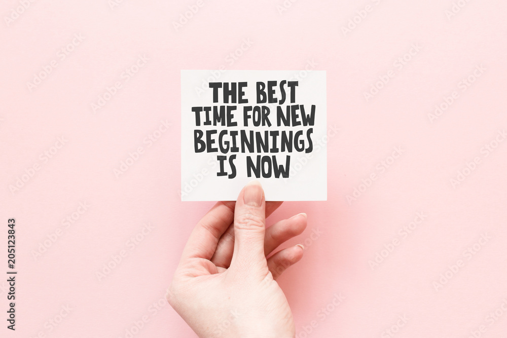 Fototapety, obrazy: Minimal composition on a pink pastel background with girl's hand hold card with quote - The best time for new beginnings is now