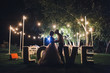 canvas print picture - Beautiful newlyweds kiss tenderly at a wedding party with lamps. Stylish wedding ceremony. Love in the frame. Designer letters.