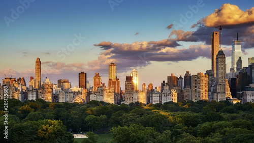 Tuinposter New York City New York City Upper East Side skyline over the Central Park at sunset, USA.