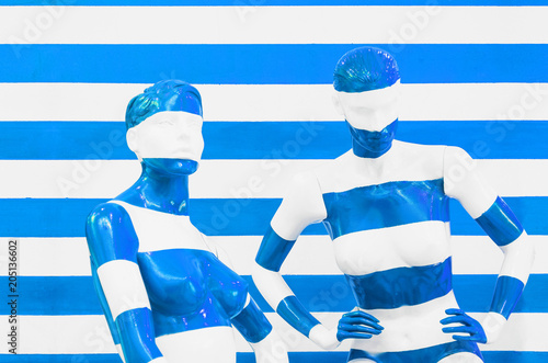 Staande foto Historisch mon. Art mannequin red and white stripes, on striped with blue and white stripes. Disguise.