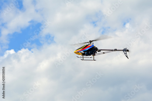 Tuinposter Helicopter Homemade radio control helicopter on blue sky.