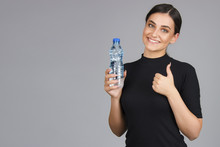 Beautiful Young Girl Holding Bottle Of Water