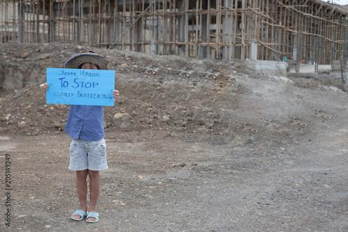 Fényképezés  Children, little girl with stop trafficking sign