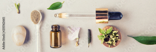 The minimal style. Natural cosmetics, handmade skin and body care. Glass bottle and vegetable ingredients. Flat lay.
