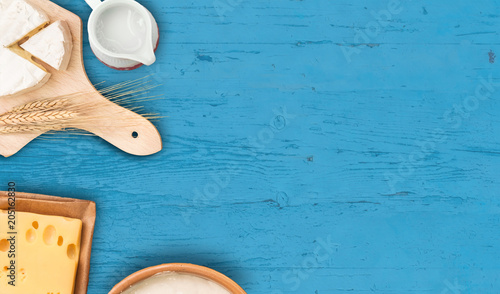 Dairy products on rustic wooden table