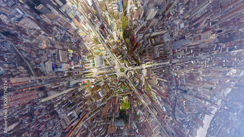 Papiers peints New York Helicopter drone shot. Aerial photography of a modern city over an area, a large crossroads, high-rise buildings, a park and roads. Panoramic city shot from above