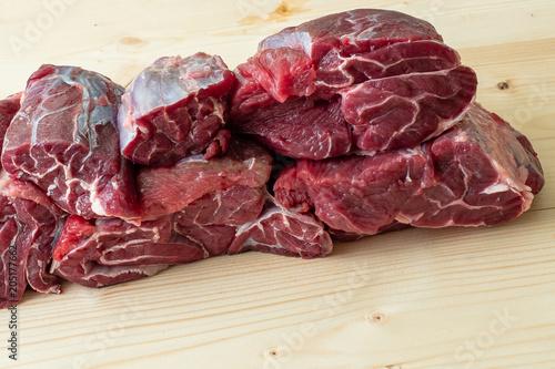 Staande foto Vlees Raw breef meat on wooden table