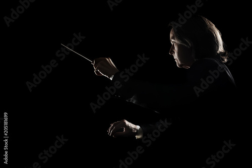 Orchestra conductor music conducting with baton