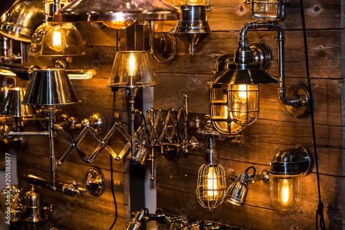 Spoed Foto op Canvas Muziekwinkel Decorative metal lamps of different shapes. Modern industrial lighting