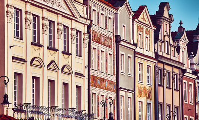 Vintage stylized old houses facades at Poznan Old Market Square, Poland.