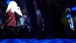 Close up of female legs in leather shoes jumping and dancing on stage in club