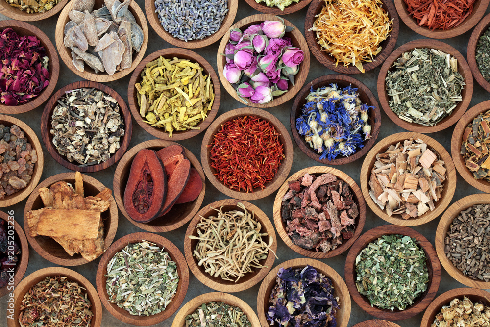 Fototapety, obrazy: Herbal medicine used in alternative remedies with a variety of dried herbs and flowers in wooden bowls. Top view.