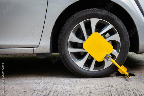 Photo Wheel lock for anti-theft with the car on the road or concrete floor