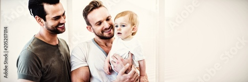 Gay couple with child at home Wallpaper Mural