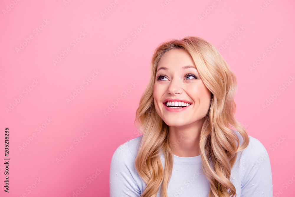 Fototapety, obrazy: Portrait with empty place of foolish childish funny girl with modern hairdo beaming smile looking at copy space laughing isolated on pink background