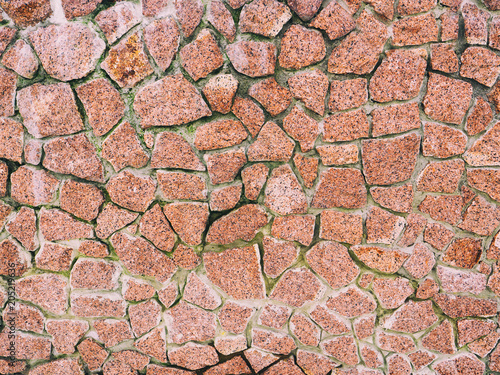 In de dag Stenen The texture of a stone fence made of granite. Background