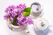Porcelain tea set decorated with lilac, summer morning