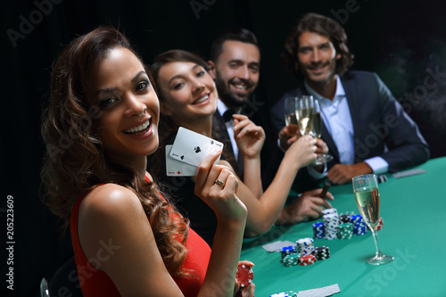 фотография  adult group celebrating friend winning blackjack