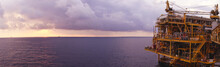 Offshore Oil And Gas Rig Platform With Beautiful Sunset Time With Storm Of Clouds In The Gulf Of Thailand For Business Industrial Concept Panorama View