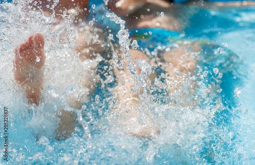 Wall Murals Crystals Legs in the pool splashing water