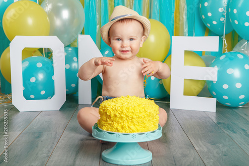 Portrait Of Cute Adorable Caucasian Baby Boy Wearing Jeans Pants And Hat Celebrating His First Birthday